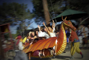 bride and groom riding the dragon