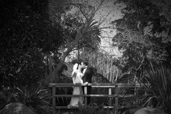 bride and groom kiss on the garden