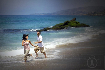 engagement running in the ocean