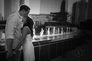 engagement kiss in the fountain
