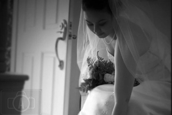 bride fixing her shoes